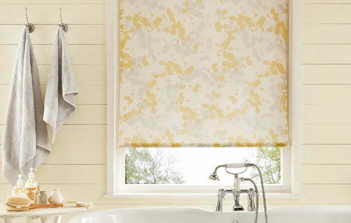 A beautiful bathroom finished off with a lovely roller blind