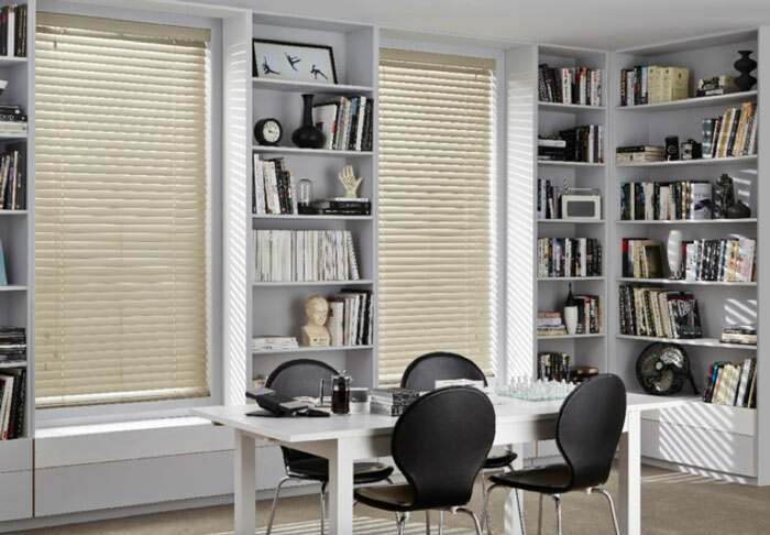 Privacy control with wooden blinds in the office