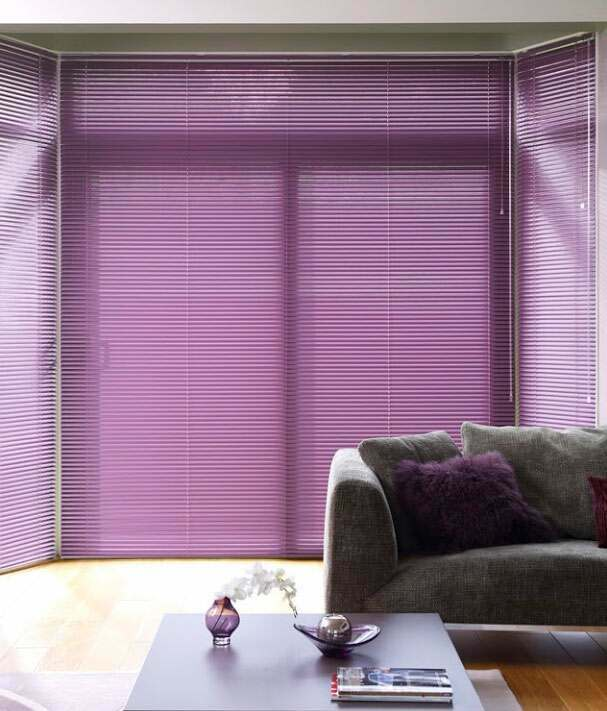 Beautiful co-ordinating metal venetian blinds in a living room