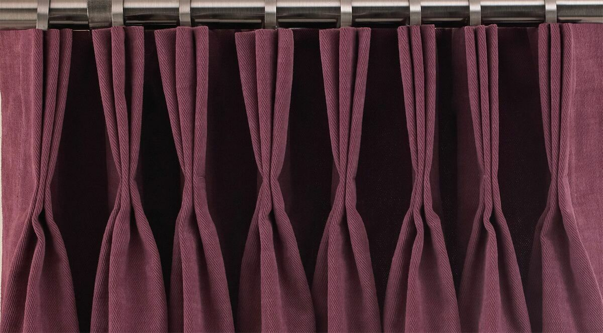 close up detail of a pinch pleated curtain header triple pinch