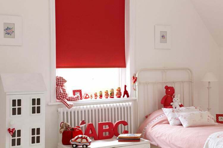 A lovely bedroom acentuated with bright red blinds